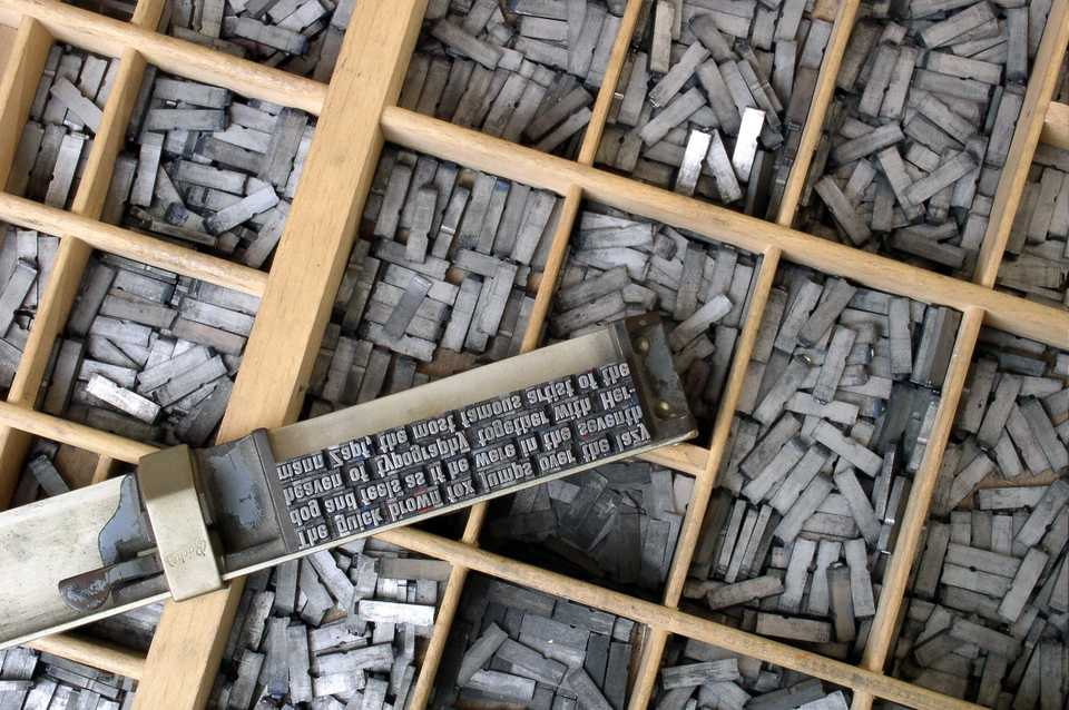 Movable metal type, and composing stick, descended from Gutenberg's press. Photo by Willi Heidelbach. Licensed under CC BY 2.5