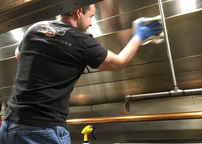 Cleaning & polishing vent hood canopy in Irving, TX