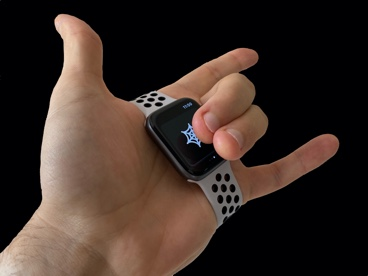 Picture of an Apple Watch strapped to the palm of your hand, making the webshooting hand pose like Spider-Man, whilst tapping on the button to make it fire up the sound effect — it's fun