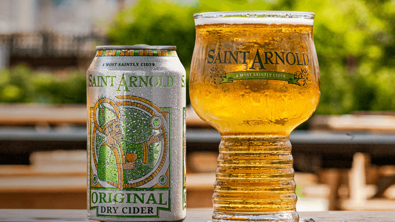 A photo of a can and a glass of Saint Arnold Brewing Company's Original Dry Cider