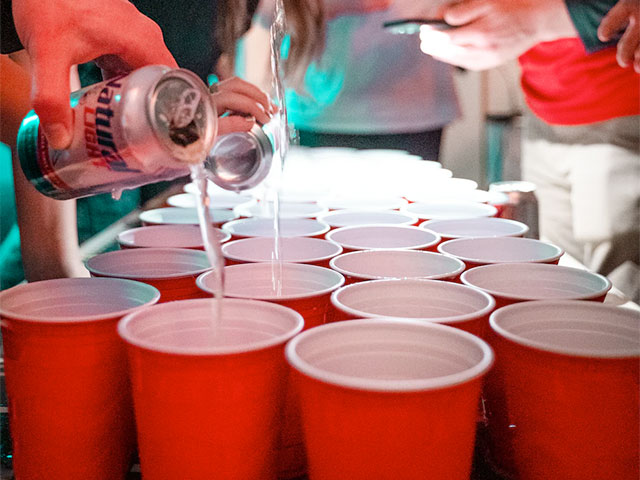 Chugging beer while playing drinking games