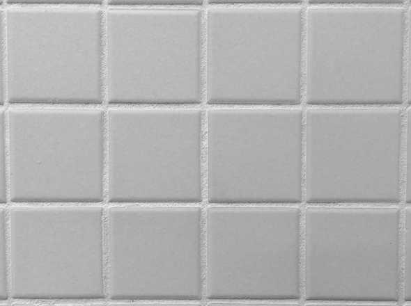 grijze tegels badkamer