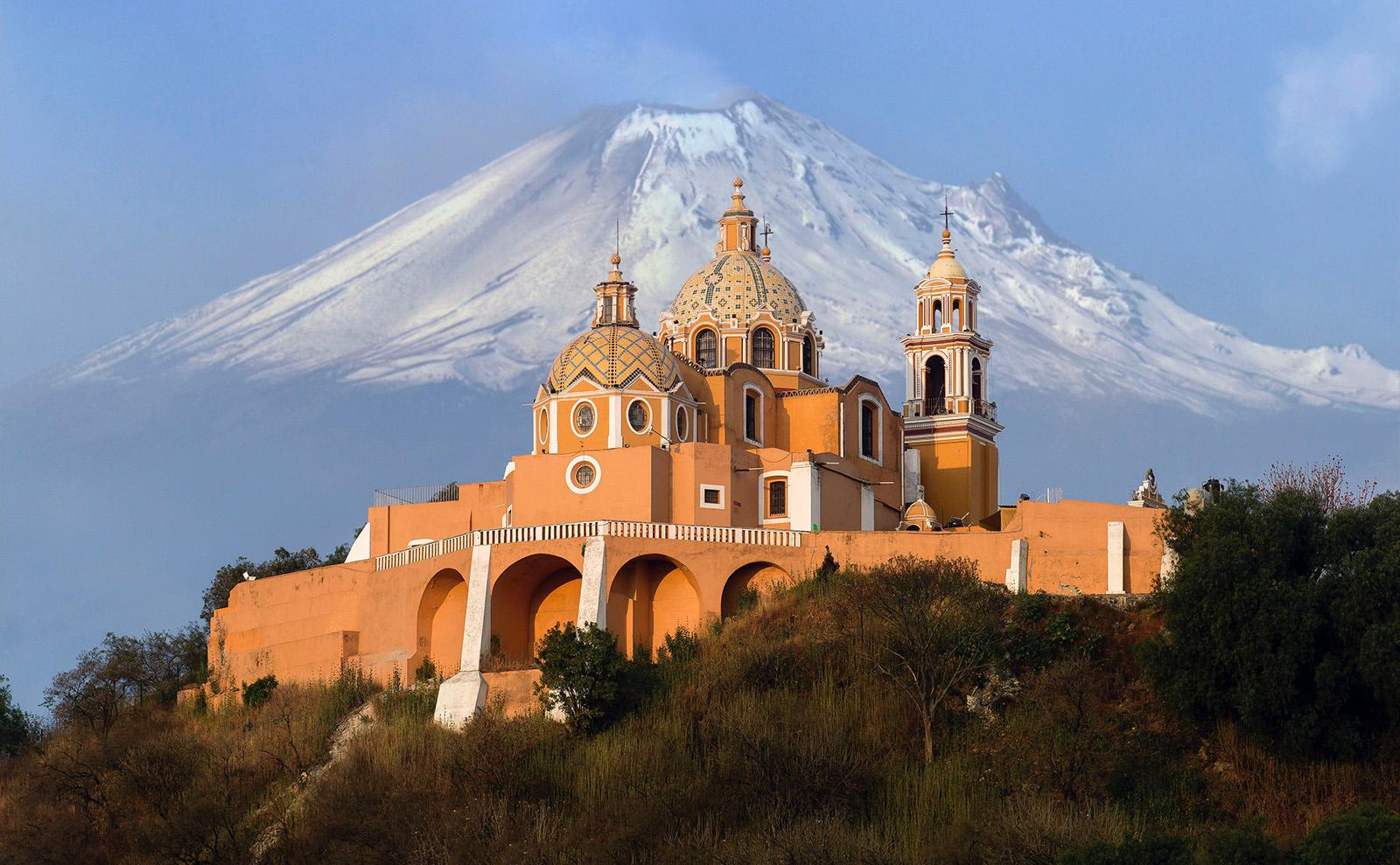 peach-colored Santuario de la Virgen de los Remedios church with domes in San Pedro Cholula, Mexico