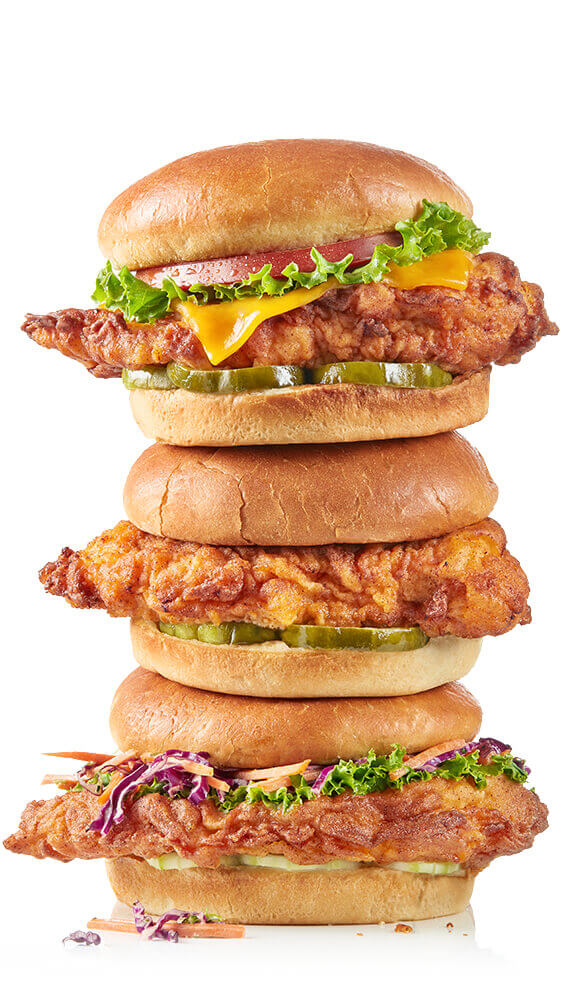 Delicious fried chicken sandwiches stacked on top of one another like a tasty tower.