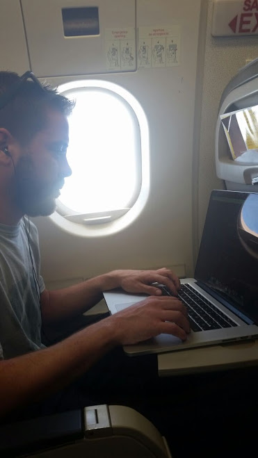 Javi working from a plane