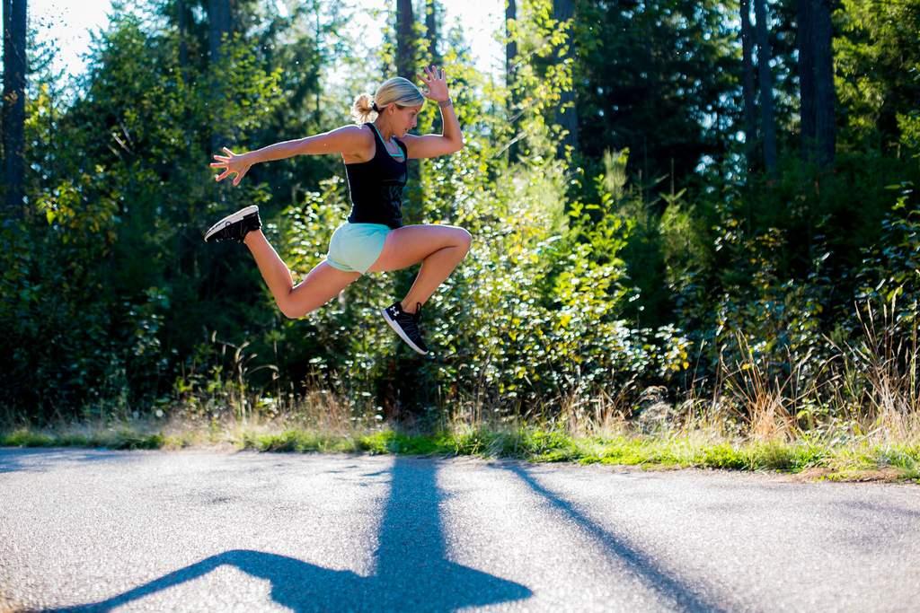 EVOLVE Strong Fitness coach outdoor run jump