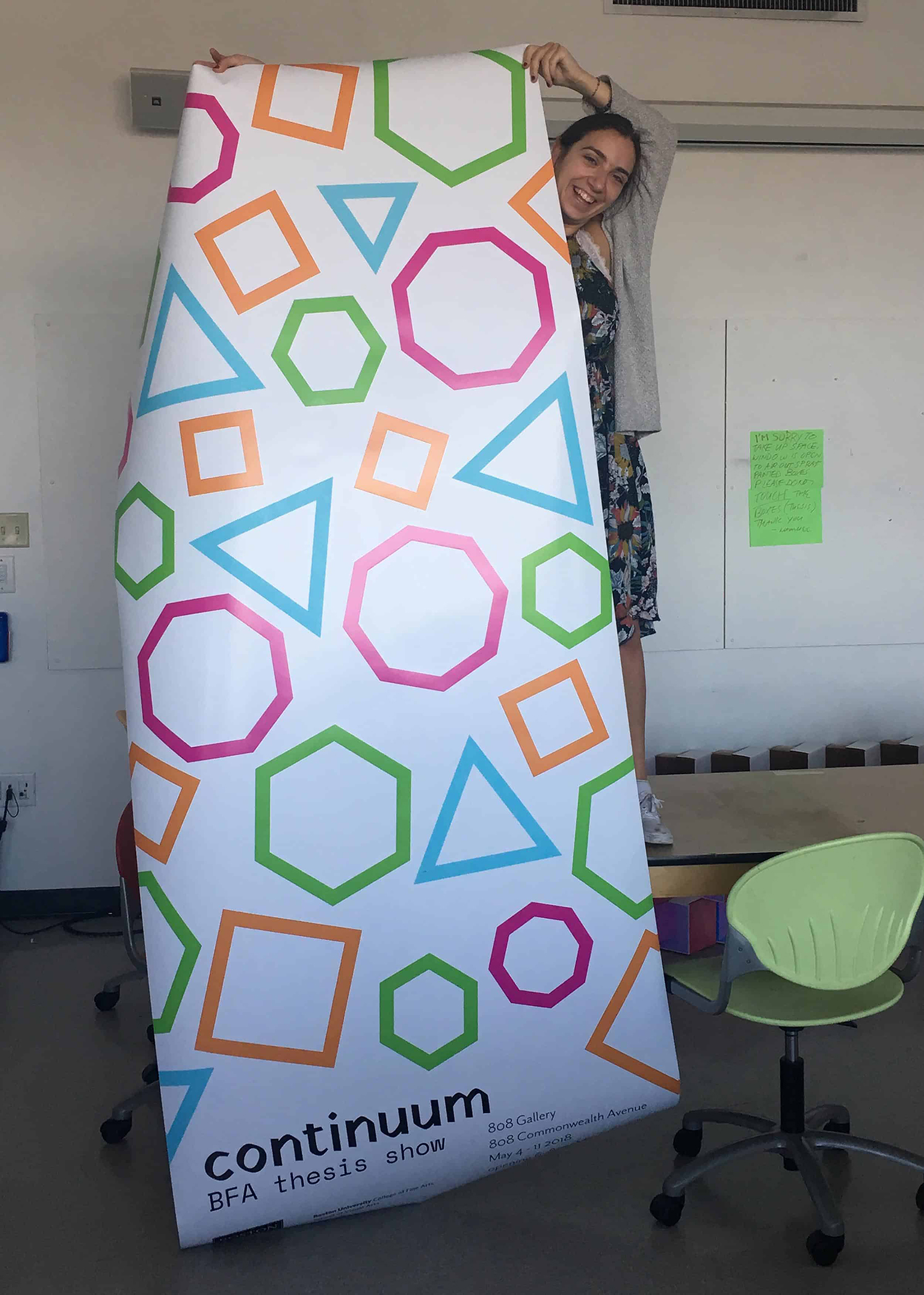 olivia standing on a table and holding a banner