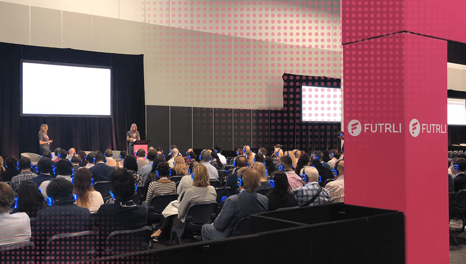 Exhibitors, Futrli doing a seminar with guest speakers for clients and prospects who are wearing earphones at Accounting Business Expo in Sydney Australia