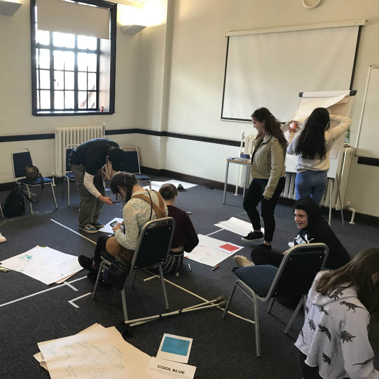 Young people working together on a creative project at Ipswich County Library