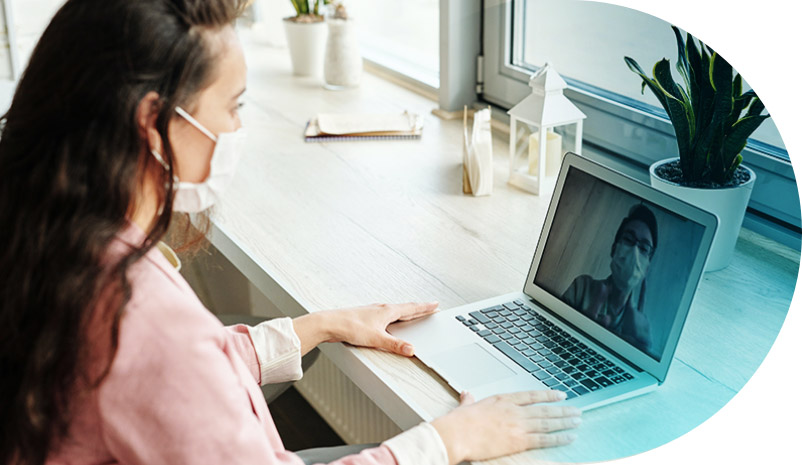 Woman in a video call with someone else, on her laptop