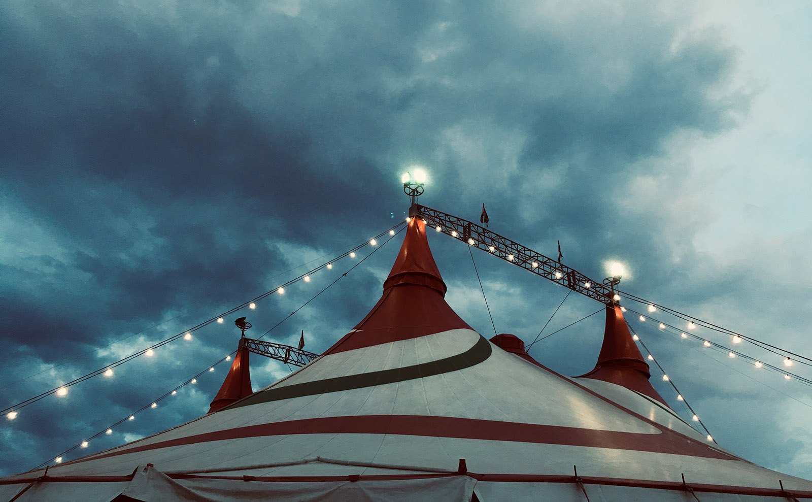stormy night sky with a striped circus tent.