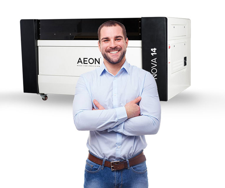 happy customer standing in front of their Aeon Nova Professional CO2 laser cutter and engraving machine