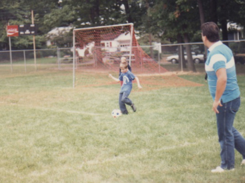 Photo of me playing soccer as a kid.