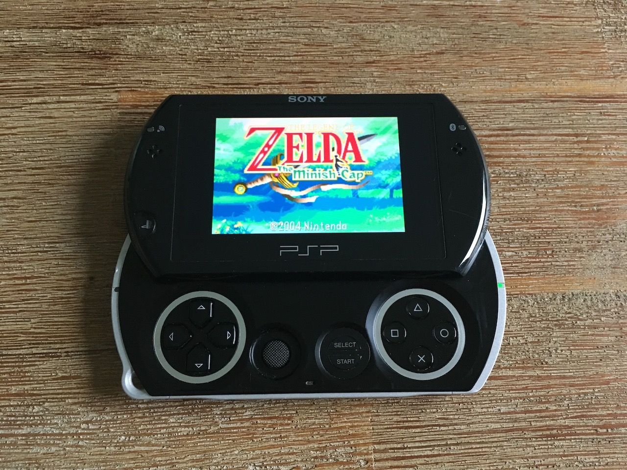A PSP Go running Zelda - The Minish Cap