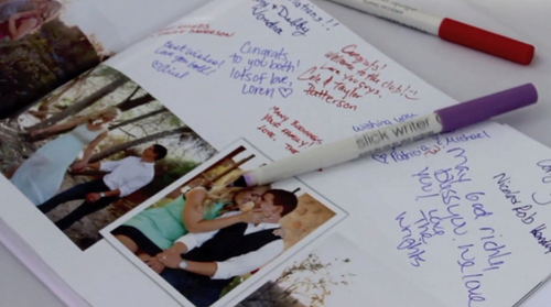 Close-up of wedding signature book