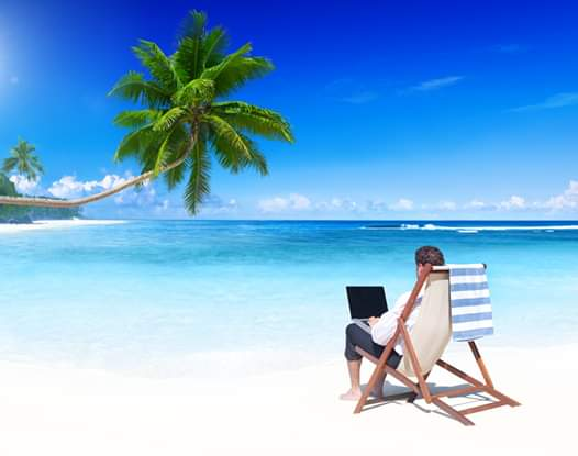 Working remotely from a beach while on holiday