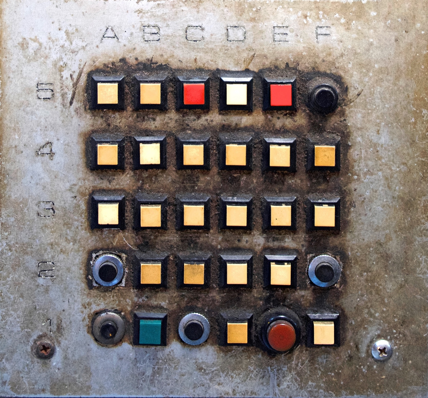 A building call system, with buttons mixed of different colours and shapes.