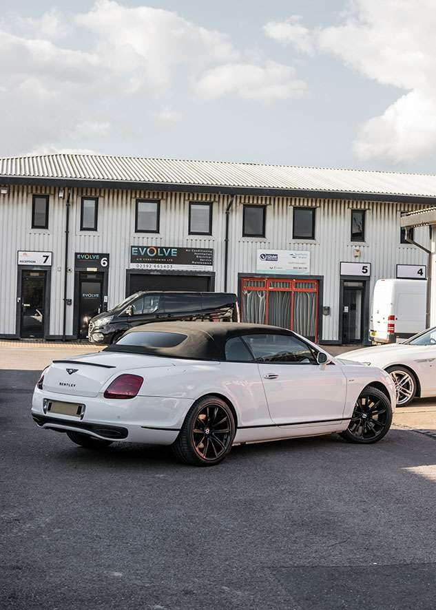 Bentley Continental GT car with tinted windows from back