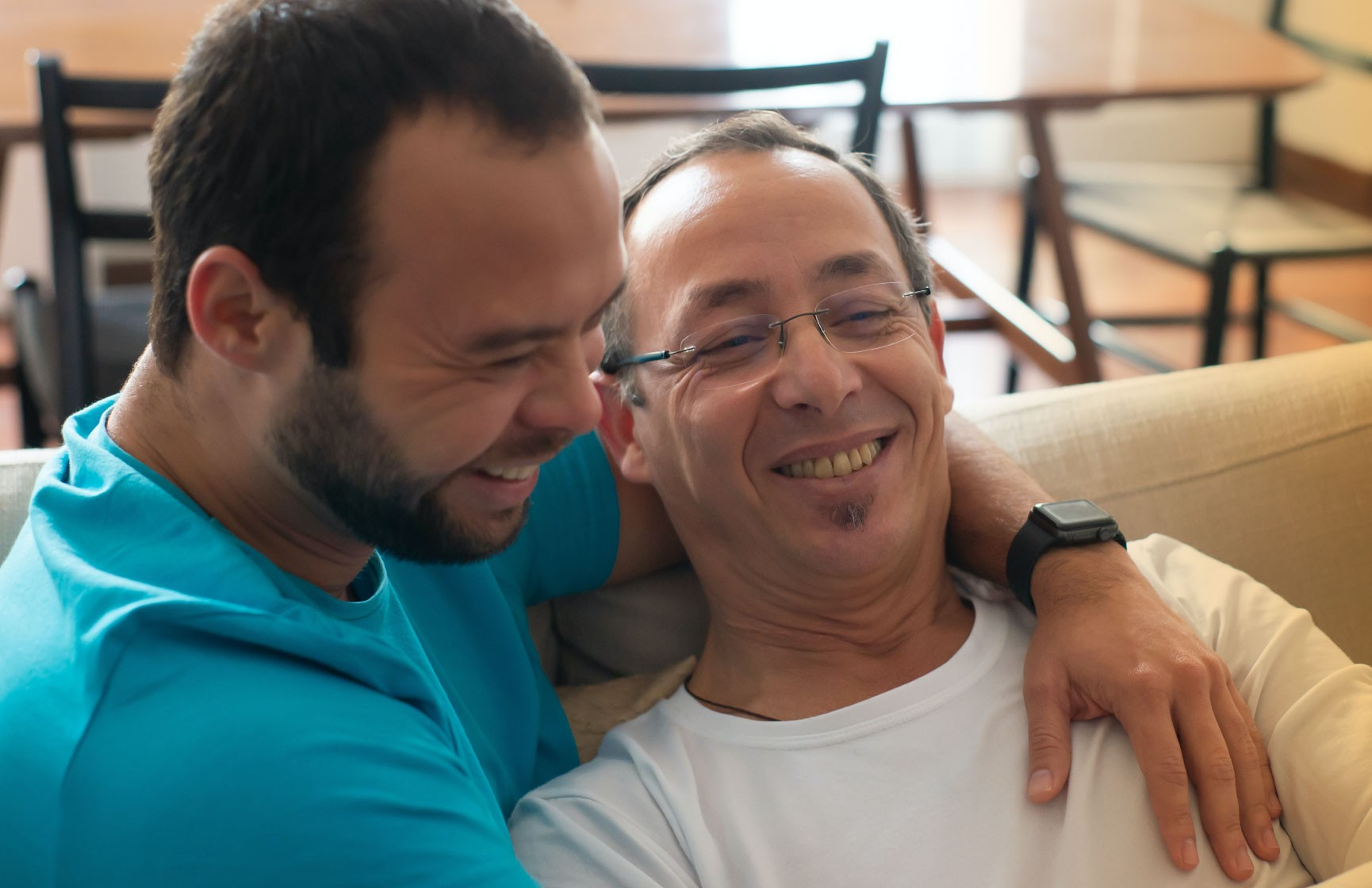 Two men embrace, showing that sexual identity and sexual behaviour do not always match