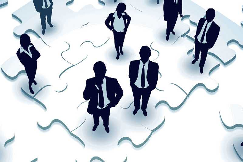 Business people on a puzzle
