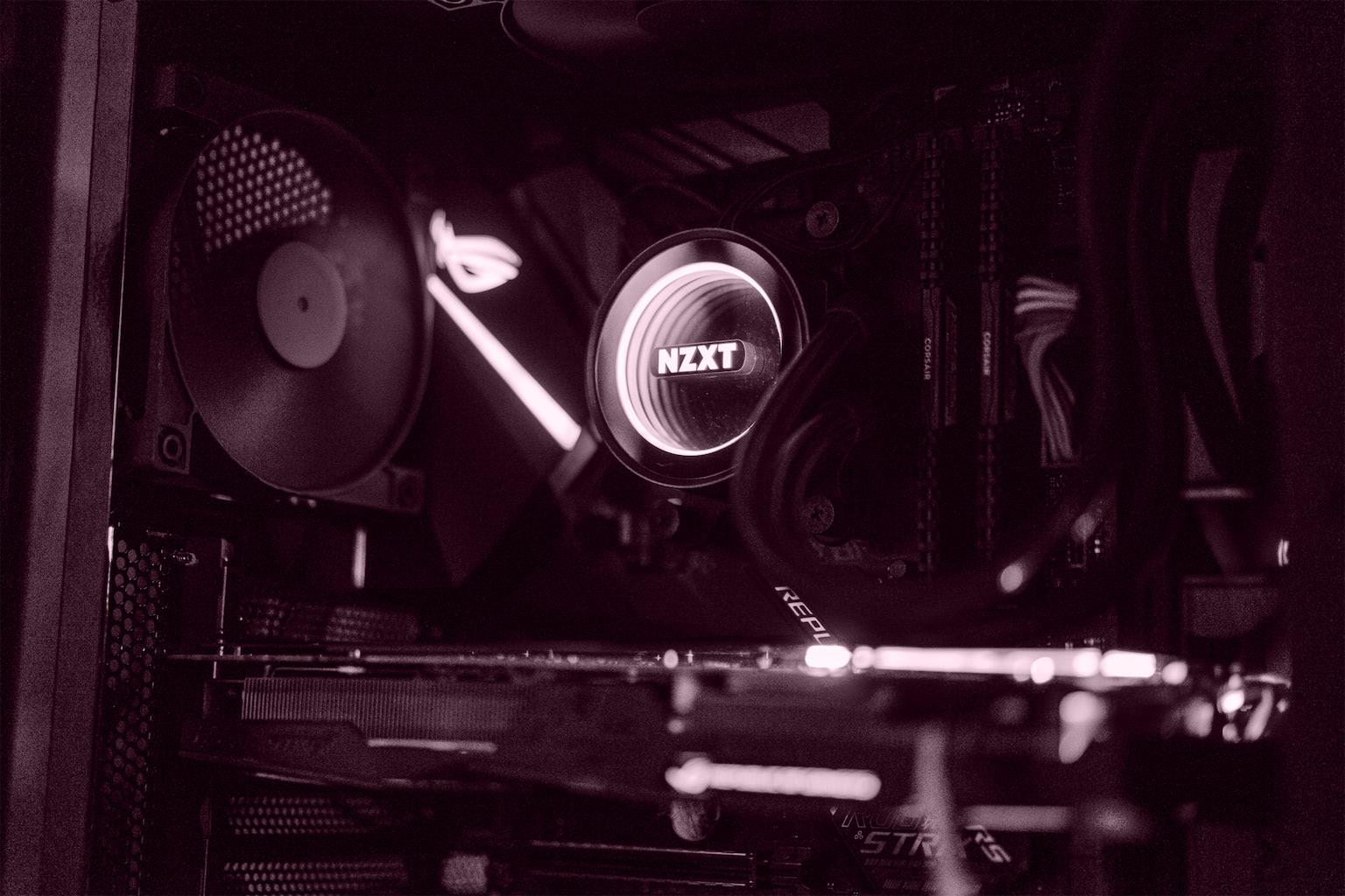 Gaming machine with the side door off exposing the illuminated NZXT CPU water cooler and GPU, 2018. Alexandria, VA.