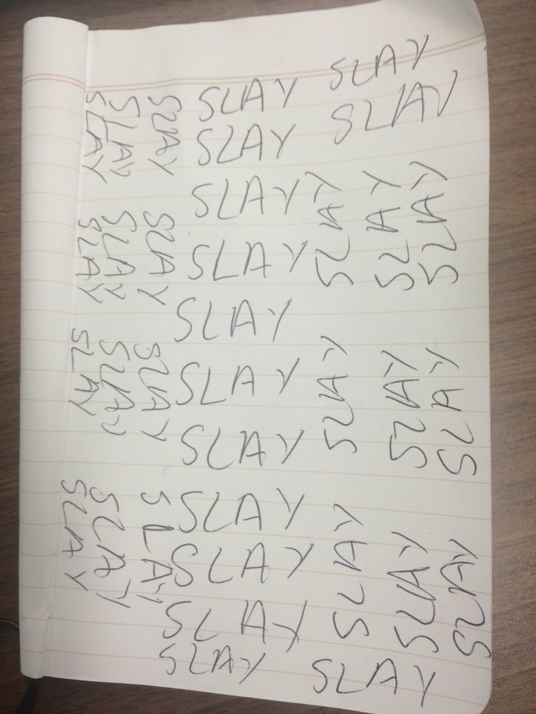 """The word """"Slay"""" written multiple times in a notebook"""