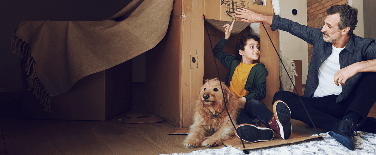 ecobee SmartSensor sets the temperature to a comfortable level as father and son celebrate their new fort.