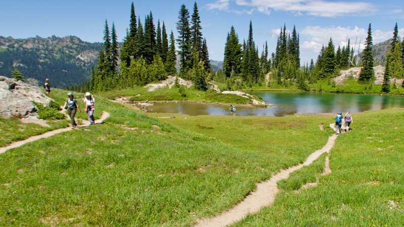 Day hikers at a small pond near Naches Peak