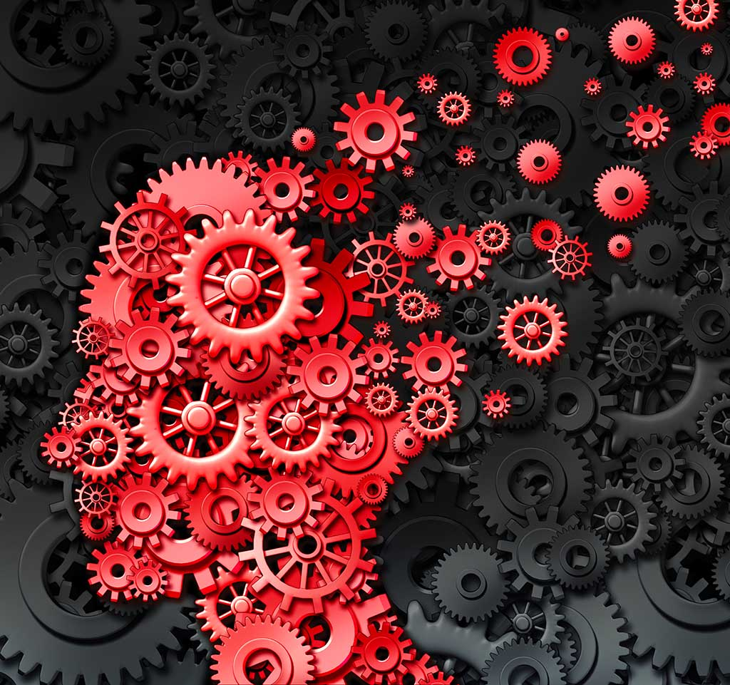 Cogs in the shape of a thinking mind illustrating brain injury and neurological memory loss .