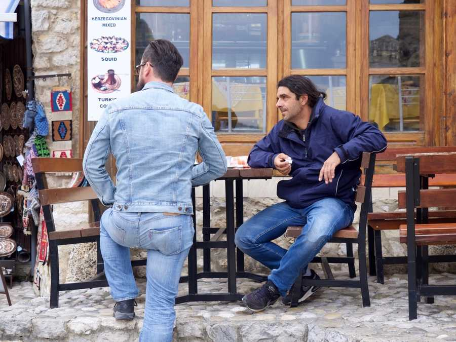 Men hanging out and drinking coffee