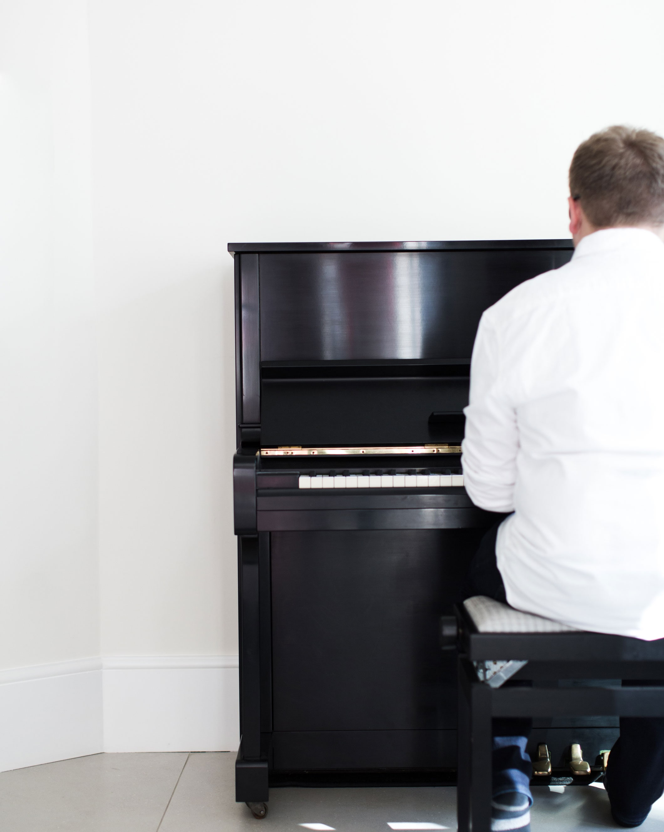 Jack Watkins hands on the piano with a dreamy background