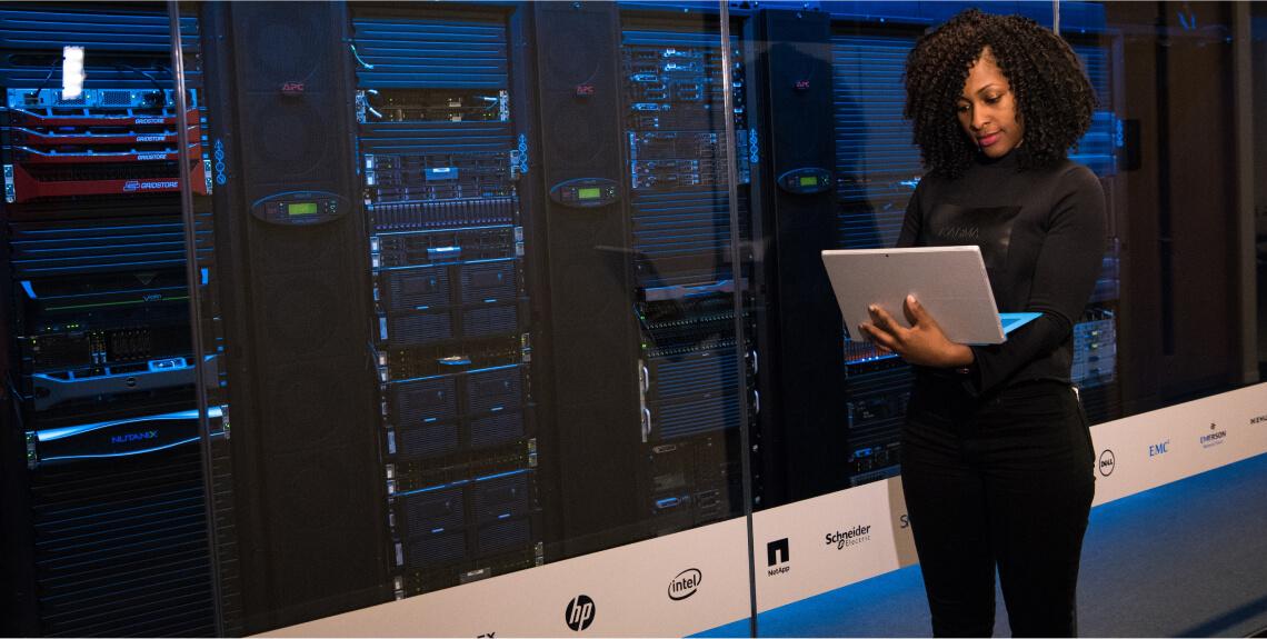 Cloud Engineer standing in server room