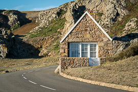 Roads here are narrow and often tightly fitted around homes.  La Porte, Jersey, United Kingdom