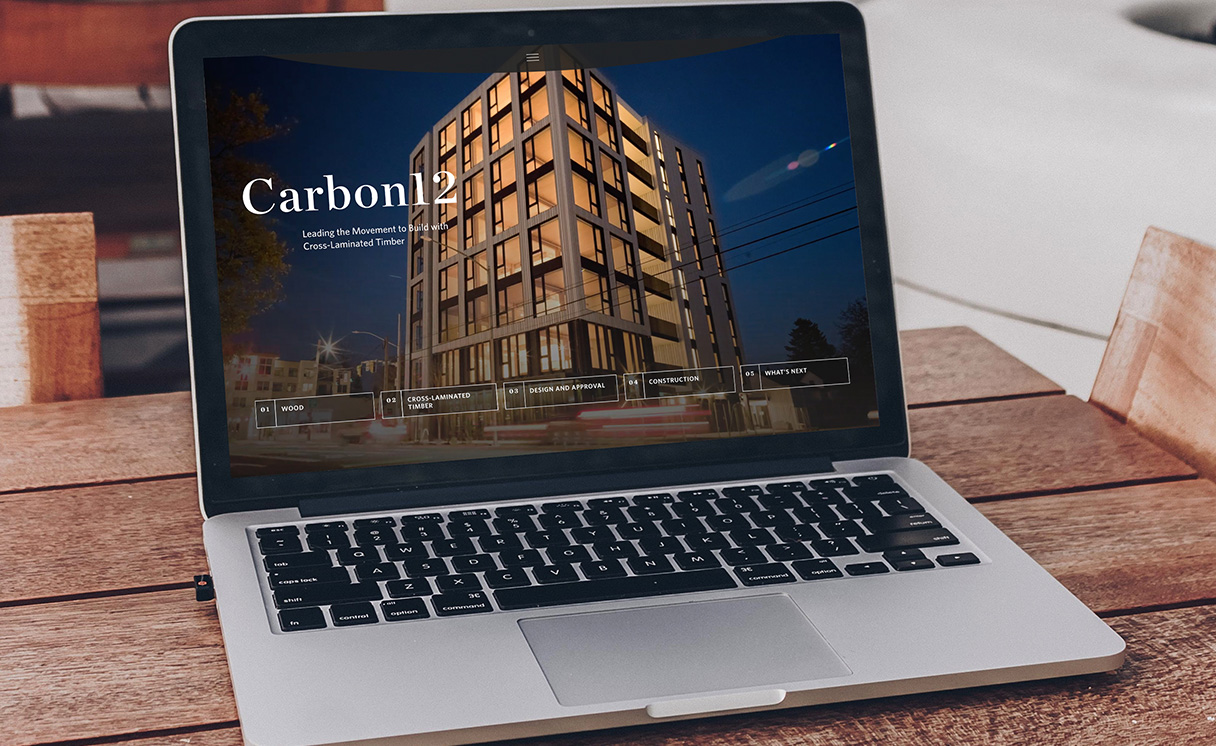 Carbon12 homepage displayed on a laptop