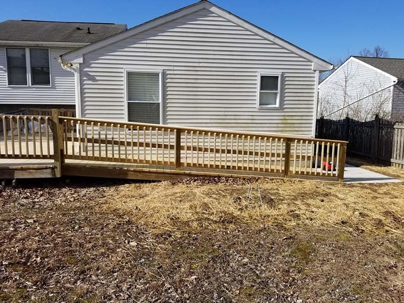 accessible ramp leading to porch with a newly constructed railing