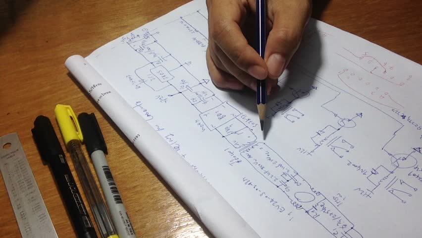 Electronics circuit sketch with pen, pencil and ruler