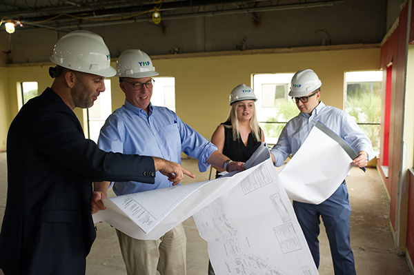 Moshe looking at plans with team