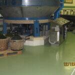 Macchinari ad uso alimentare, poggiati sul rivestimento resinoso di un'azienda alimentare della provincia di Treviso.