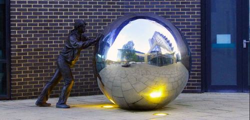 Statue pushing Ball in Leeds