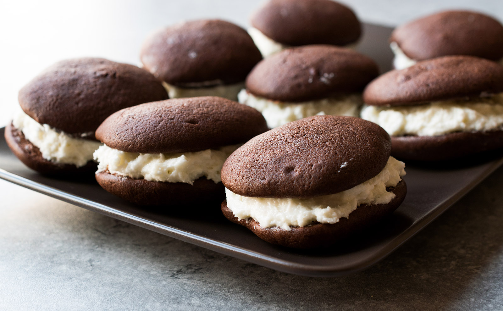 cream-filled whoopie pies on a wooden table