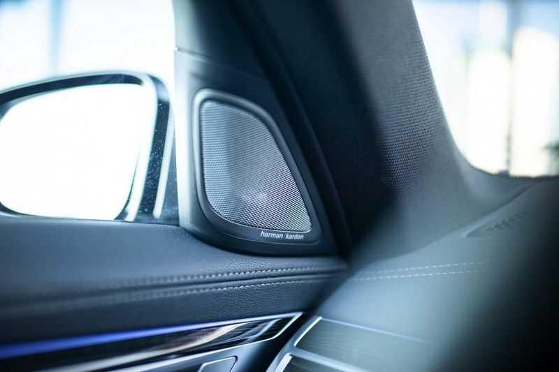 BMW 7 Serie 740d xDrive *Schuifdak / H&K / Memory / LED / ACC / Stoelventilatie* afbeelding 23