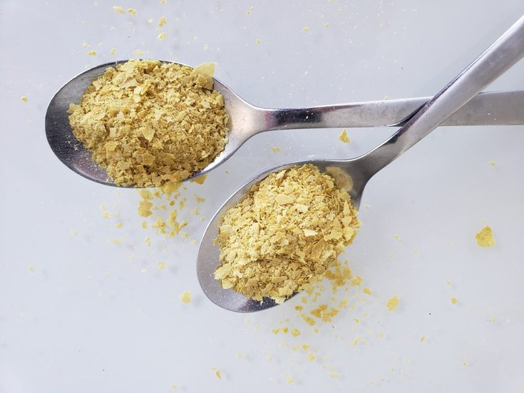 Two spoonfuls of nutritional yeast