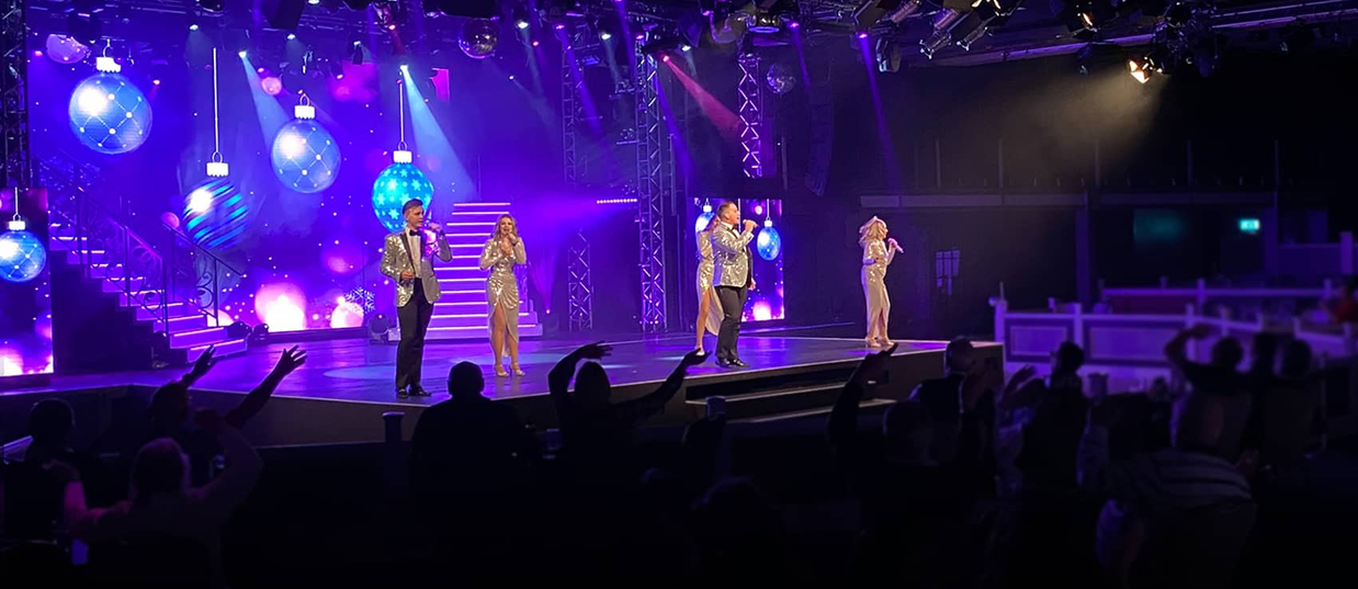 Entertainers singing on stage