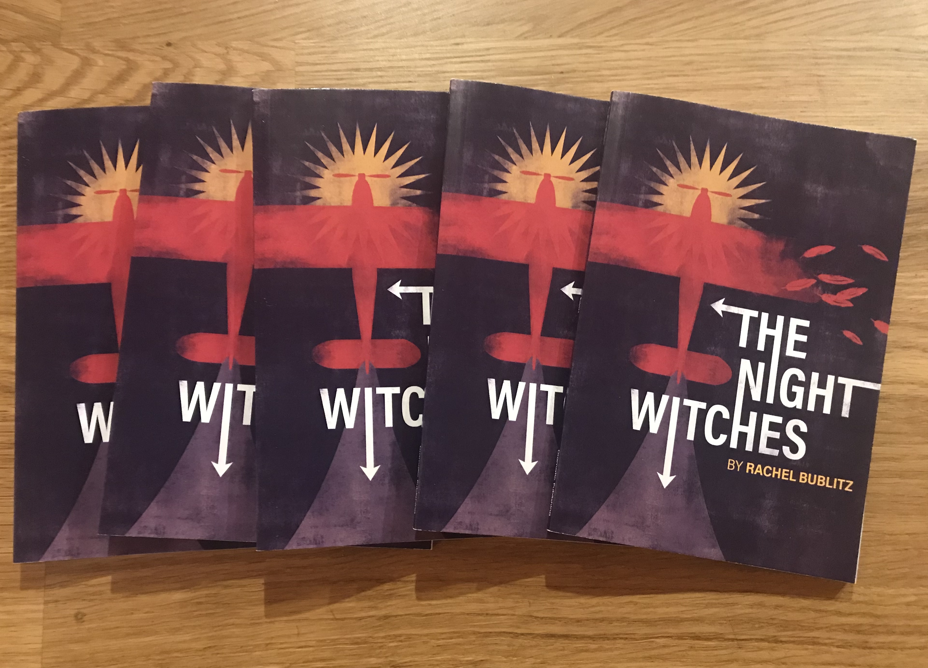 Photo of a stack of THE NIGHT WITCHES scripts from Dramatic Publishing.