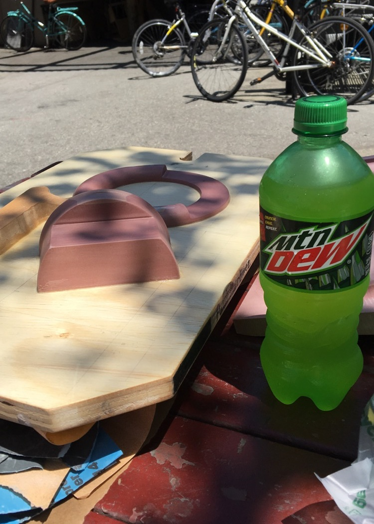 The completed pattern board, with a victory Mountain Dew for reaching a major milestone