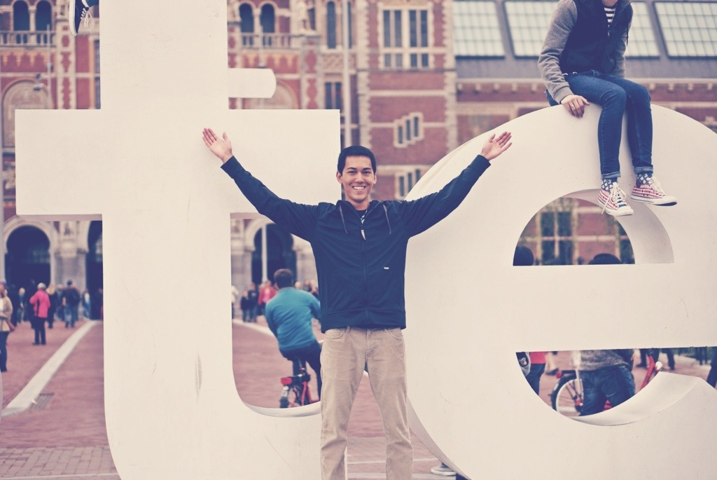 Tye in front of Amsterdam letters