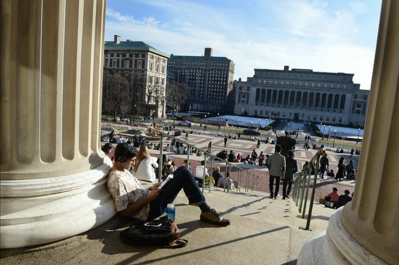 Students sitting outside on the campus of Columbia University