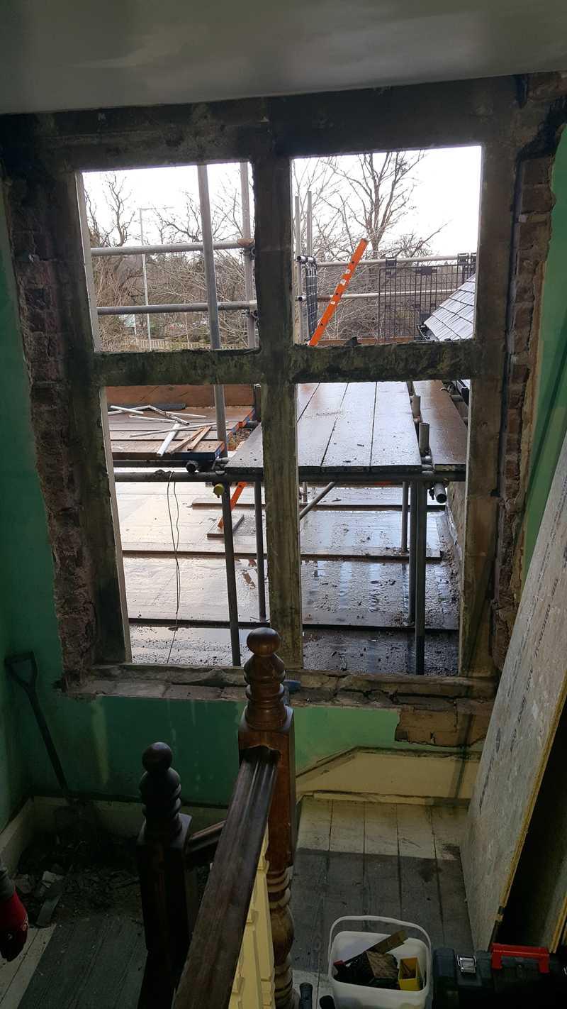 Landing-bay window in a very poor state of repair