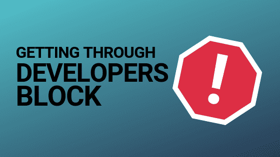 Stop sign with blog article title 'getting through developers block'