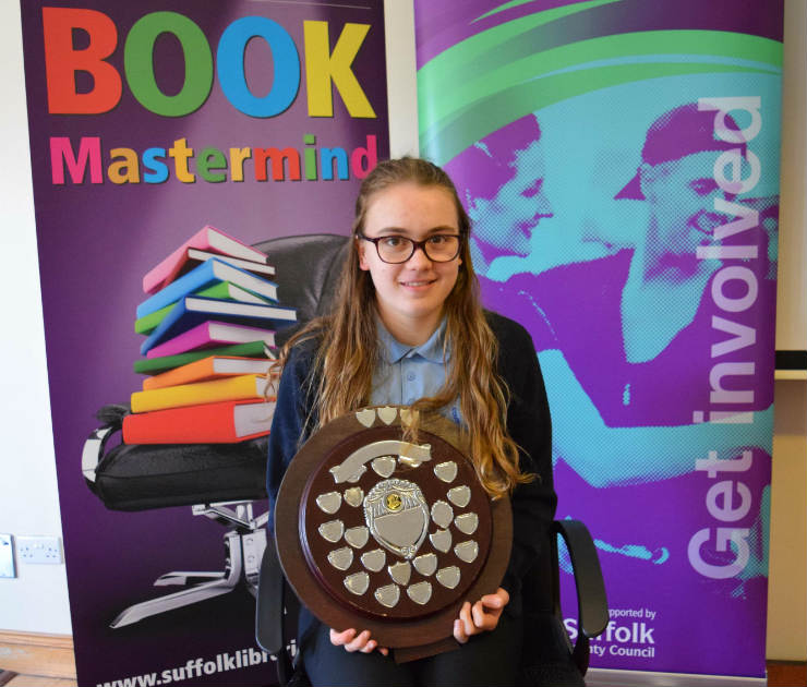 Katy Shaw with the Book Mastermind trophy